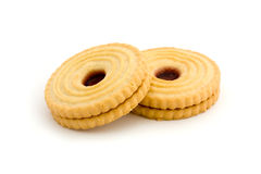 Two jam filled biscuits over white Royalty Free Stock Image