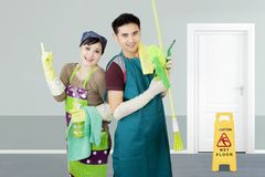 Two janitors standing in the corridor hotel Stock Images