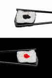 Sushi in The Chopsticks. Typical Japanese Food. Two Japan sushi roll in the chopsticks isolated on white and black background Royalty Free Stock Photo