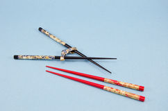 Two japanese chinese chopsticks pair on blue background Stock Image