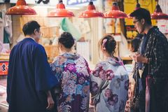 Two japanese couples in traditional kimono at Omicho Ichiba market, Kanazawa, Japan stock image
