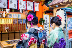 Two japanese girls dressed wit Royalty Free Stock Photography