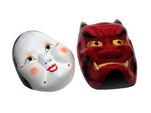 Two Japanese masks-clipping path. Two Japanese masks isolated over white background with clipping path Stock Images
