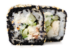 Two Japanese square rolls with black tobiko roe, sesame seeds an Royalty Free Stock Photography
