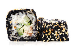Two Japanese square rolls with black tobiko roe, sesame seeds an Stock Images