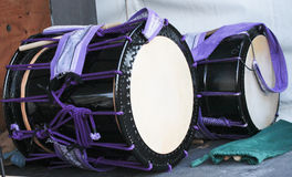 Two Japanese Taiko percussion drums. Black and purple Japanese Taiko drums Stock Photo