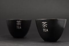 Two japanese teacups. On black background Stock Image