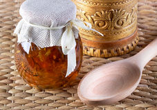 Two jar of honey on rustic background. Stock Photography