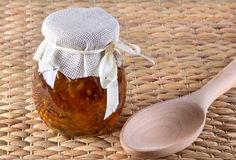 Two jar of honey and spoon on rustic background. Royalty Free Stock Photo