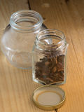 two jar over wooden background Royalty Free Stock Photos
