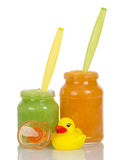 Two jars of baby food, pussy and toy isolated Royalty Free Stock Photography