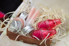 Two jars with bright lip balm, four jars of cream and two lipsti Royalty Free Stock Photography