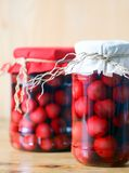 Two jars of cherry compote Stock Images