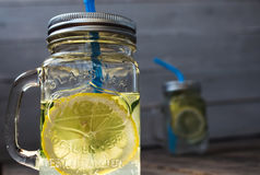 Two jars with a drink with slices of cucumber and lemon stock photo