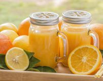 Two Jars Fresh Orange Juice Royalty Free Stock Images
