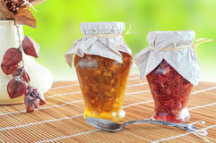 Two jars of fruit jam Stock Images