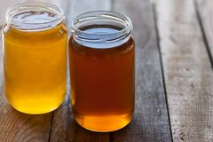 Two jars of honey Royalty Free Stock Images