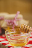 Two jars of honey and honeycombs isolated on white Royalty Free Stock Photography