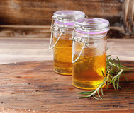 Two jars of honey with rosemary Royalty Free Stock Photo