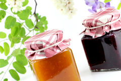 Two jars of jam, perspective view Royalty Free Stock Photography