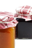 Two jars of jam, staggered Royalty Free Stock Images