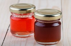 Two jars of jam on a wooden table Royalty Free Stock Photos
