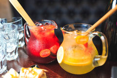 Two jars of lemonade. Red and yellow lemonade in jars Royalty Free Stock Photography
