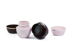 Two jars of ointment. For lips, pink and brown, isolated Royalty Free Stock Photo