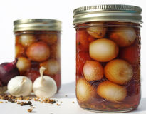 Two jars of onions. Jar of pickled onions with fresh onions and spices Royalty Free Stock Photos