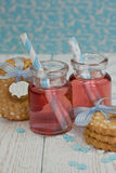 Two jars with pink lemonade. And cookies Stock Photos