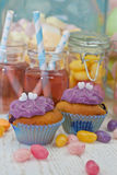 Two jars with pink lemonade. And colorful sweets and cupcakes Royalty Free Stock Photography