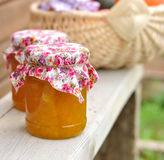 Two Jars of Pumpkin Jam on a Bench, copy space for your text Stock Images