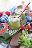 Two jars with warm pea soup Royalty Free Stock Image