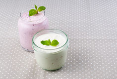 Two jars of yogurt cream Royalty Free Stock Photos