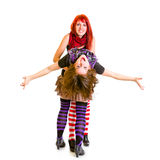 Two jaunty girlfriends funny embracing. Isolated on white Royalty Free Stock Photos