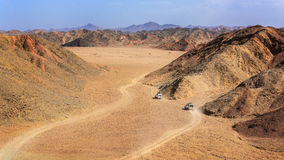 Two jeep in the desert. In the picture two jeeps while attraverano the desert rocks Egyptian, a view from above royalty free stock images