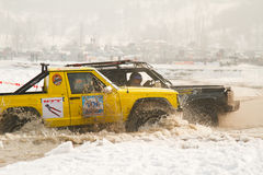 Two jeeps collided in the water at the races Royalty Free Stock Photography