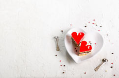 Two jelly heart-shaped cakes on white concrete background. Free space for your text. Royalty Free Stock Images