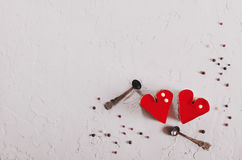 Two jelly heart-shaped cakes on white concrete background. Free space for your text. Toned effect. Stock Photo