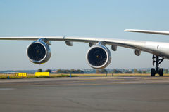 Two jet engines. Detail telephoto of two huge engines of an large aircraft while taxiing royalty free stock photography