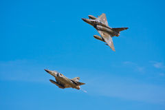 Two Jet Planes. Two military jet fighters Mirage 2000N making aerobatic display Royalty Free Stock Image