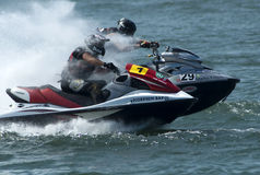 Two Jet Ski drivers in duel Stock Image