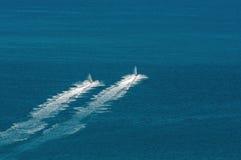 Two jet-skies riding Stock Photo