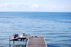 Two jet skiis on a dock Royalty Free Stock Photography