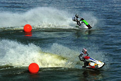 Two jetskis riding from red balls. Two jetskis riding at high speed from two red balls Stock Photo