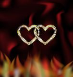 Two jewel hearts and fire Stock Photos