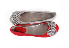 Two jeweled flat shoes. On a white background stock photo