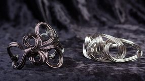 Two jewelry twisted bracelets Royalty Free Stock Images