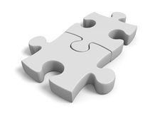 Two jigsaw puzzle pieces locked together in a connected position. Pair of matching parts from a jigsaw puzzle linked together on a white background Stock Photos