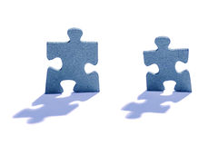 Two Jigsaw Puzzle Pieces on White Stock Photos